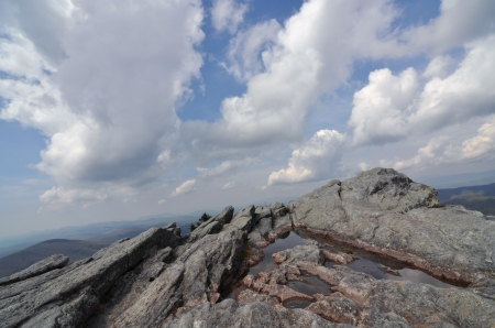 White clouds sweeping over a high mountain peak at Grandfather Mountain. photo