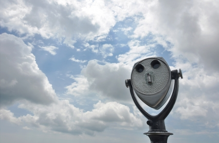 Coin-operated tourist binoculars aimed at a cloudy sky. photo