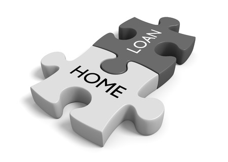 linked together: House ownership and financing concept of two puzzle pieces linked together with the words home loan