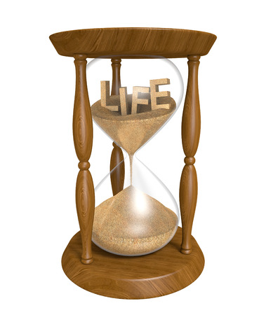 finite: Time passing as sand in an old hourglass trickles down and life runs out Stock Photo