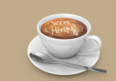 Latte art message in a coffee cup that says we are hiring