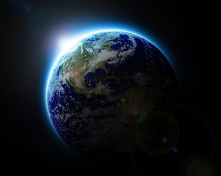earth from space: Sun rising over blue planet Earth as seen from space  Stock Photo