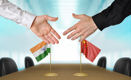 agreeing: India and China diplomats agreeing on a deal Stock Photo