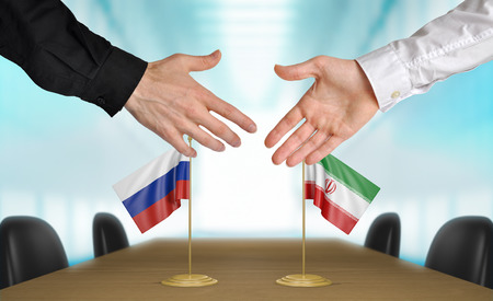 agreeing: Russia and Iran diplomats agreeing on a deal