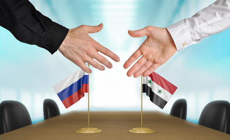 agreeing: Russia and Syria diplomats agreeing on a deal