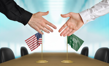 agreeing: United States and Saudi Arabia diplomats agreeing on a deal Stock Photo