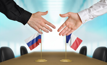 diplomats: Russia and France diplomats agreeing on a deal