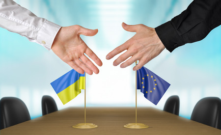 agreeing: Ukraine and European Union diplomats agreeing on a deal Stock Photo
