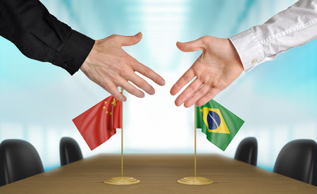 agreeing: China and Brazil diplomats agreeing on a deal