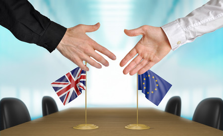 agreeing: United Kingdom and European Union diplomats agreeing on a deal