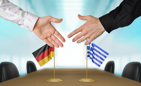 agreeing: Germany and Greece diplomats agreeing on a deal Stock Photo