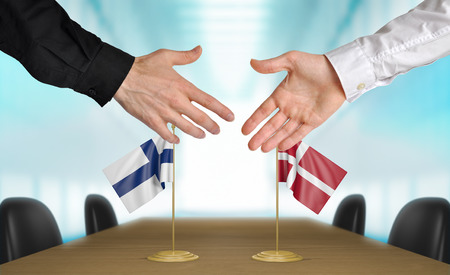 agreeing: Finland and Denmark diplomats agreeing on a deal Stock Photo