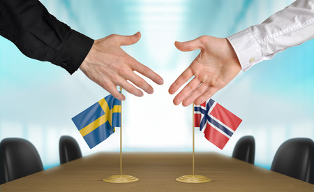agreeing: Sweden and Norway diplomats agreeing on a deal Stock Photo