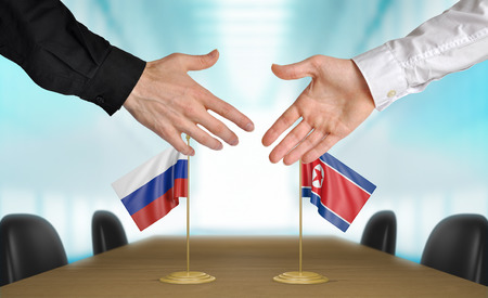 diplomats: Russia and North Korea diplomats agreeing on a deal Stock Photo