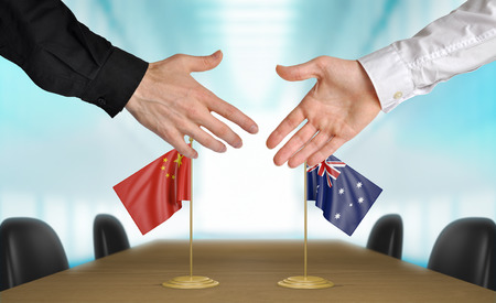 china flag: China and Australia diplomats agreeing on a deal