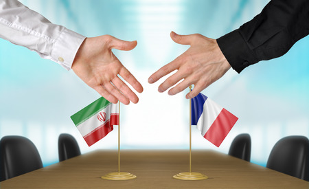 agreeing: Iran and France diplomats agreeing on a deal Stock Photo