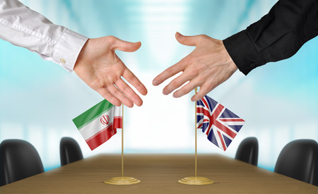 agreeing: Iran and United Kingdom diplomats agreeing on a deal