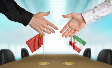 foreign nation: China and Iran diplomats agreeing on a deal
