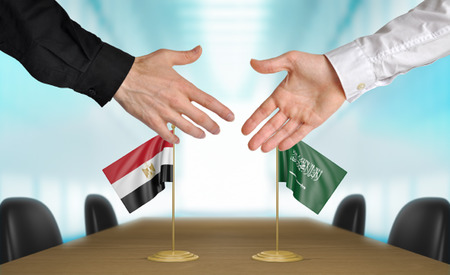 agreeing: Egypt and Saudi Arabia diplomats agreeing on a deal