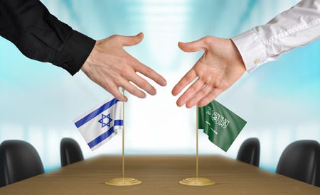 agreeing: Israel and Saudi Arabia diplomats agreeing on a deal Stock Photo