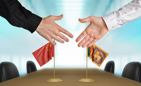agreeing: China and Sri Lanka diplomats agreeing on a deal Stock Photo