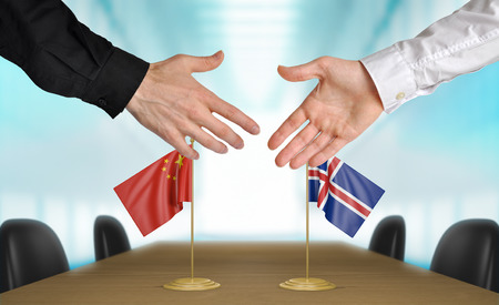 diplomats: China and Iceland diplomats agreeing on a deal