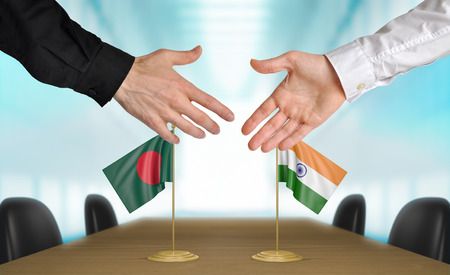 agreeing: Bangladesh and India diplomats agreeing on a deal