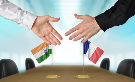 foreign policy: India and France diplomats agreeing on a deal Stock Photo