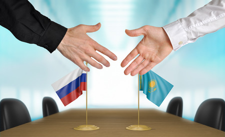 agreeing: Russia and Kazakhstan diplomats agreeing on a deal