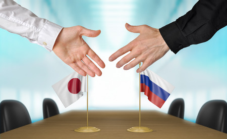 agreeing: Japan and Russia diplomats agreeing on a deal