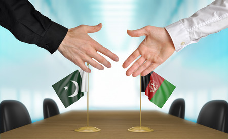 agreeing: Pakistan and Afghanistan diplomats agreeing on a deal