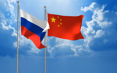 foreign policy: Russia and China flags flying together for diplomatic talks Stock Photo