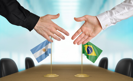 agreeing: Argentina and Brazil diplomats agreeing on a deal