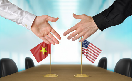 agreeing: Vietnam and United States diplomats agreeing on a deal