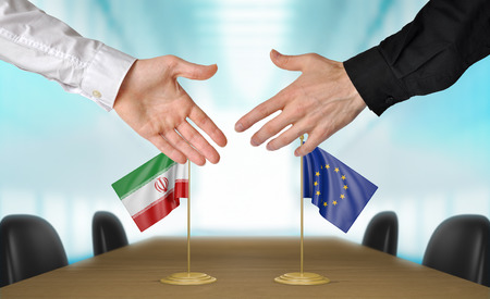 agreeing: Iran and European Union diplomats agreeing on a deal Stock Photo