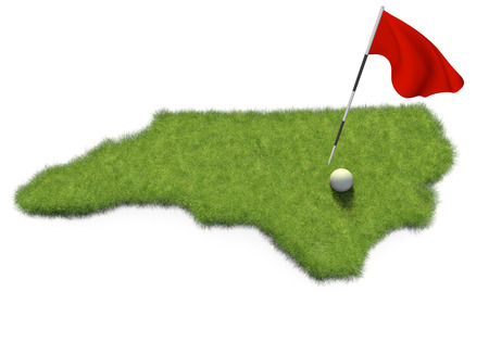 putting green: Golf ball and flag pole on course putting green shaped like the state of North Carolina