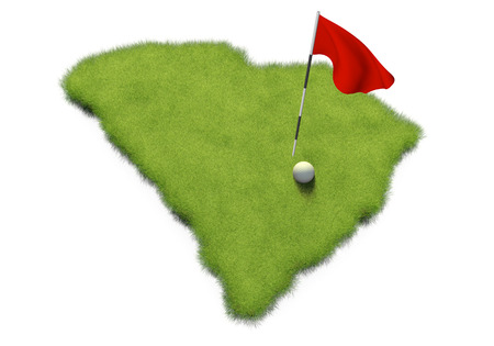 putting green: Golf ball and flag pole on course putting green shaped like the state of South Carolina Stock Photo