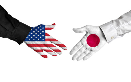 foreign policy: American and Japanese leaders shaking hands on a deal agreement