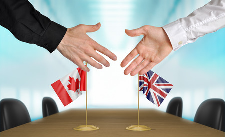 diplomats: Canada and United Kingdom diplomats agreeing on a deal