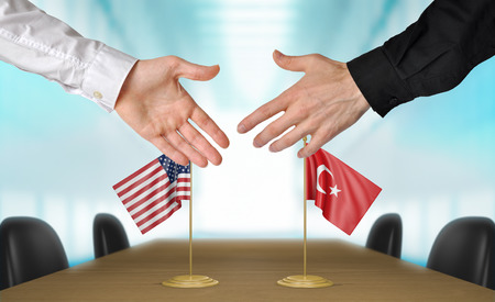 turkish flag: United States and Turkey diplomats agreeing on a deal Stock Photo