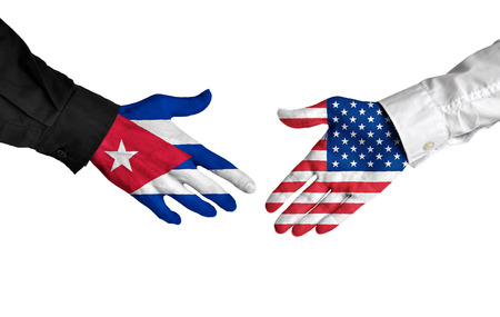 union flag: Cuban and American leaders shaking hands on a deal agreement Stock Photo