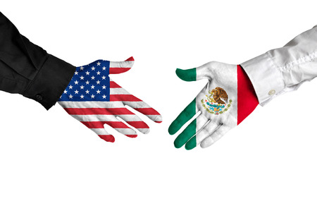 foreign policy: American and Mexican leaders shaking hands on a deal agreement