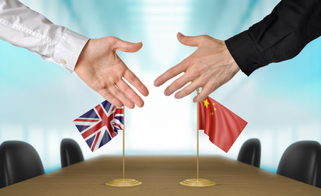 diplomats: United Kingdom and China diplomats agreeing on a deal