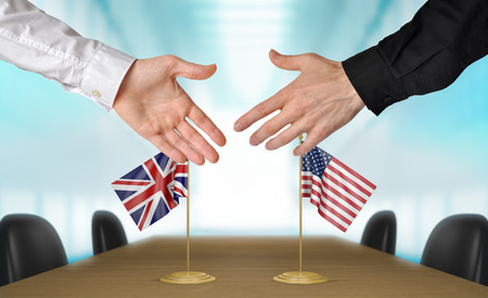 diplomats: United Kingdom and United States diplomats agreeing on a deal