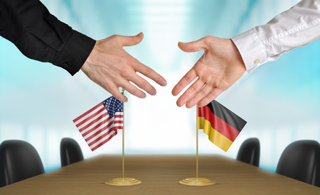 agreeing: United States and Germany diplomats agreeing on a deal