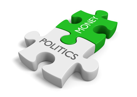 Politics and money puzzle pieces representing the corruption of wealth in elections Foto de archivo