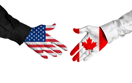 agree: United States and Canada leaders shaking hands on a deal agreement