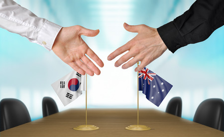 agreeing: South Korea and Australia diplomats agreeing on a deal Stock Photo