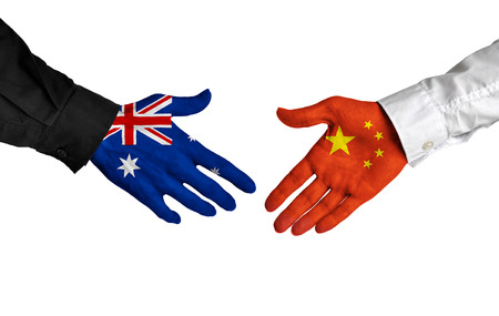 australia: Australia and China leaders shaking hands on a deal agreement