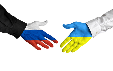 alliance: Russia and Ukraine leaders shaking hands on a deal agreement